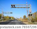 railway crossing, level crossing, a level crossing 76507296