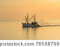 Fishing trawler with trawl nets at sunset, Buesum, North Sea, Schleswig-Holstein, Germany 76508709