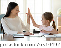 Happy mom and small daughter finish homework give high five 76510492