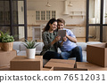 Happy couple using tablet, choosing moving service for relocation 76512031