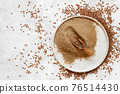 Raw Flax seeds flour in a plate with a spoon 76514430
