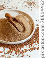 Raw Flax seeds flour in a plate with a spoon 76514432