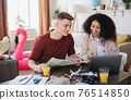 Young couple with laptop packing for holiday, coronavirus concept. 76514850