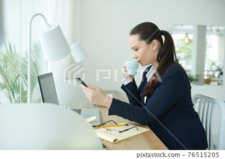 Female entrepreneuir checking phone 76515205