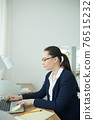 Businesswoman concentrated on work 76515232