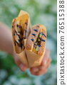 Fast food: banana, pear and chocolate sandwiches in a napkin 76515388