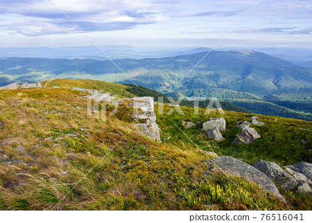 landscape of carpathian mountains. stones on the hill. view in to the distant valley. clouds on the sky in morning light. wonderful travel destination 76516041