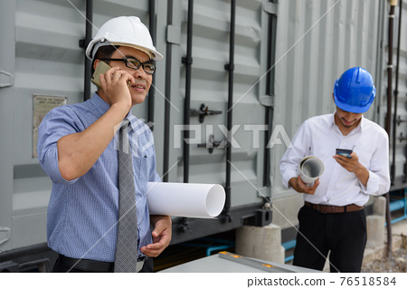 Professional engineer discuss project on phone 76518584