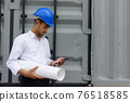 Arab engineer check project plan on phone 76518585