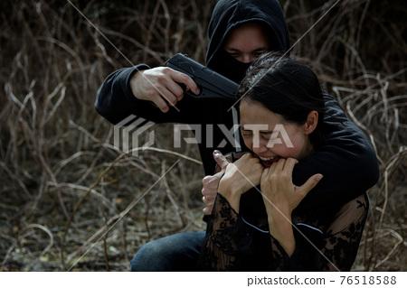 thief threaten gun to screaming young woman 76518588