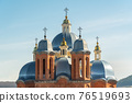 Domes Europe, Orthodox and Catholic Church. Close-up, against the background of the sky. 76519693