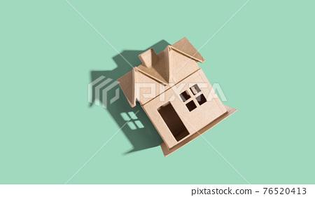 Cardboard house with drop shadow 76520413
