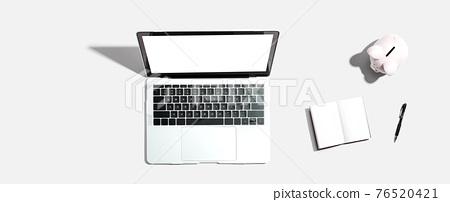 Laptop computer with piggy bank 76520421