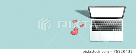 Laptop computer with craft heart drawings 76520435