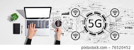 5G network with person using laptop computer 76520452