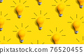 Yellow light bulb pattern with shadow 76520455