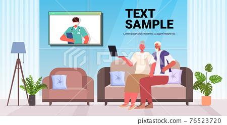 senior couple discussing with doctor during video call online medical consultation coronavirus quarantine 76523720