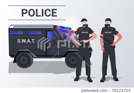 police officers in tactical gear riot policemen couple standing together near car protesters and demonstration control 76523724