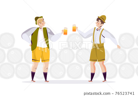 people in traditional clothes drinking beer celebrating Oktoberfest party friends having fun 76523741