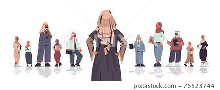 rear view businesswoman standing in front of arabic businesspeople team leader leadership concept 76523744