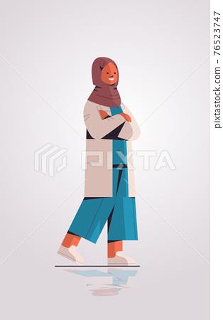 muslim woman doctor in uniform arabic female medical professional standing pose medicine healthcare 76523747