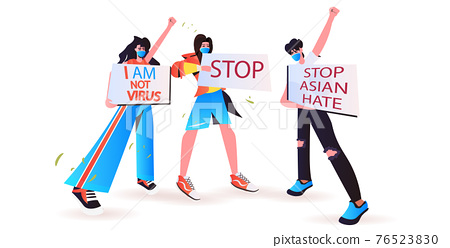 stop asian hate activists in masks holding banners against racism support people during coronavirus pandemic 76523830
