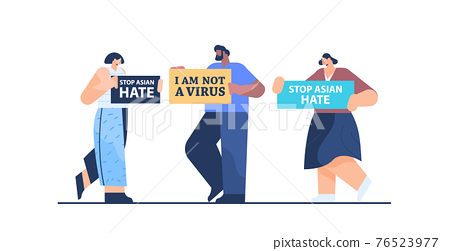 people holding text banners against bullying and racism stop asian hate support during covid-19 pandemic 76523977