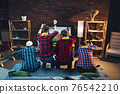 Group of friends watching TV, sport match together. Emotional fans cheering for favourite team, watching on exciting game. Concept of friendship, leisure activity, emotions 76542210