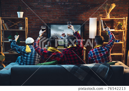 Group of friends watching TV, sport match together. Emotional fans cheering for favourite team. Top view. Concept of friendship, leisure activity, emotions 76542213