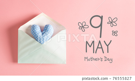 Mother's Day message with a blue heart cushion 76555827
