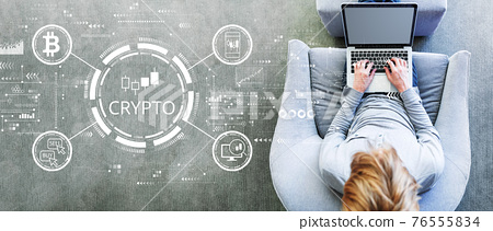 Crypto Trading theme with man using a laptop 76555834