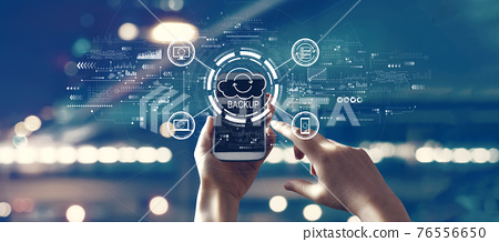 Backup concept with person using smartphone 76556650