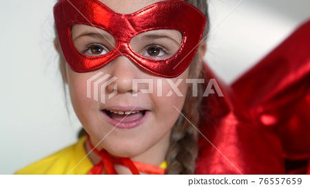 girl superhero portrait face. feminism a happy family a close-up home kid dream concept. child superhero in mask. Beautiful winner kid girl superhero. child play hero. business leader concept 76557659