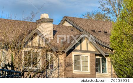 Top of residential building in light of golden sunset 76558951