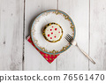 Small pie in an old plate with a dessert fork 76561470