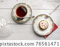 Small pie in an old plate with a cup of tea 76561471