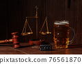 Glass of beer, car keys and wooden judge gavel in a notary office. Alcohol and law concept 76561870