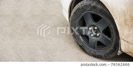 Close-up of metal rim of car wheel. Detail of car with a lot of copyspace 76562666