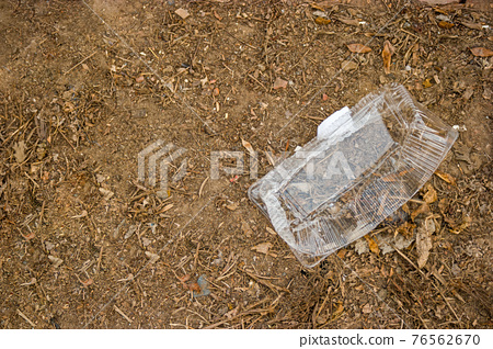 Pack plastic bare ground show long life garbage concept, litter needs recycling 76562670
