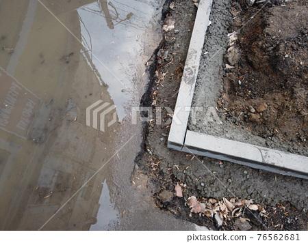 New concrete curb stones angle. Road repair concept. 76562681
