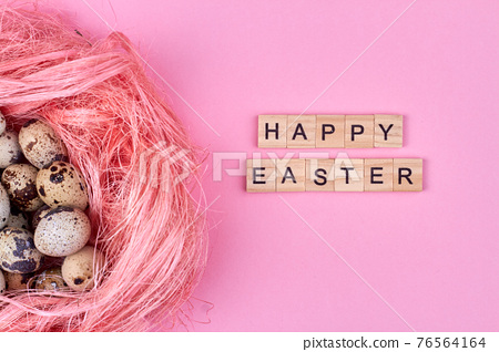 Happy easter concept. Pink quail egg and happy easter wish. 76564164