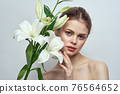 woman with white flowers on gray background portrait close-up makeup mode 76564652