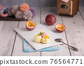 Scoops of passion, vanilla and strawberry ice cream on a white plate 76564771