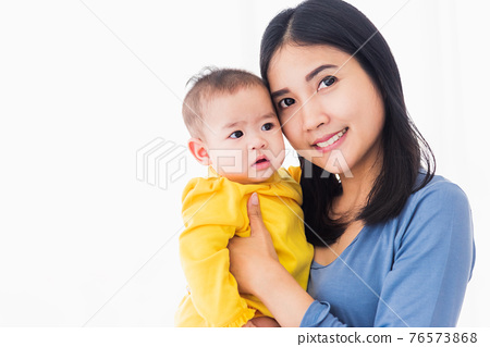 mother holding his newborn little baby in her arms 76573868