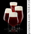 Set of fresh draft beer glasses with bubble froth isolated on black background. 76581418