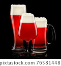 Set of fresh draft beer glasses with bubble froth isolated on black background. 76581448