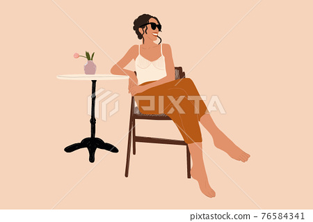 Woman sitting on the chair with coffee table  76584341