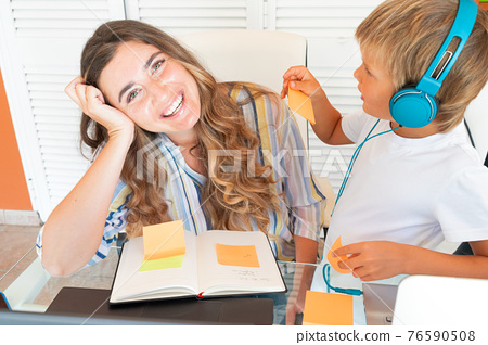 Mother working home with son 76590508