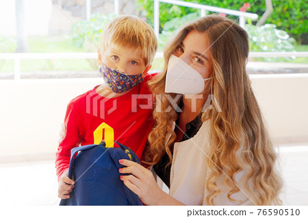 Mother and boy going to school 76590510