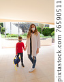 Mother and boy going to school 76590511
